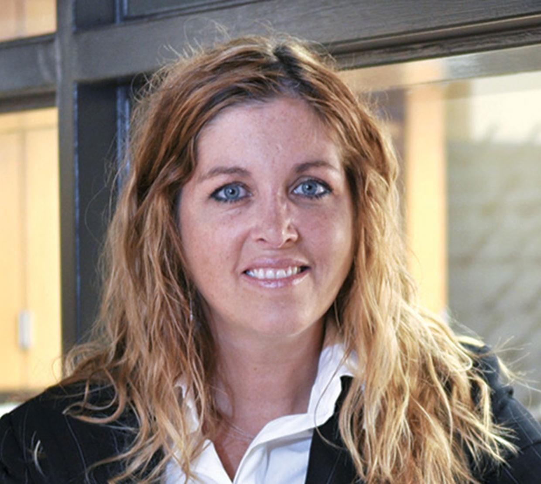 Karen Wooley standing in hallway in front of window