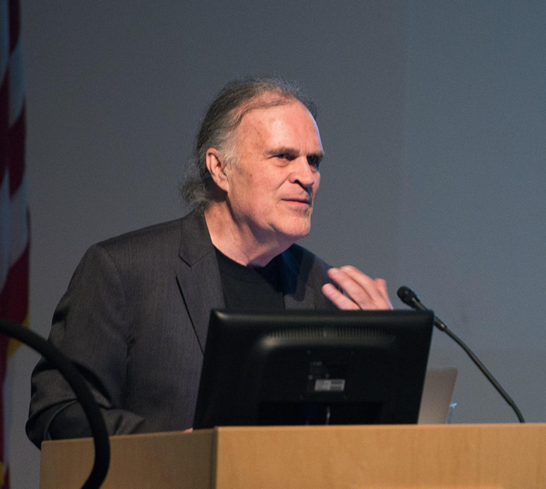 Ed Waymire talking on podium