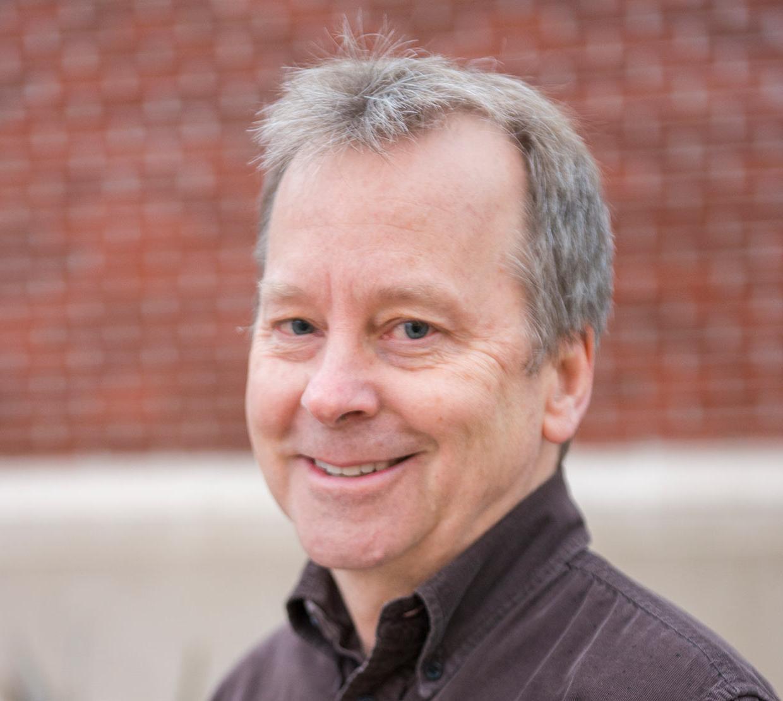 Doug Keszler standing in SEC awning