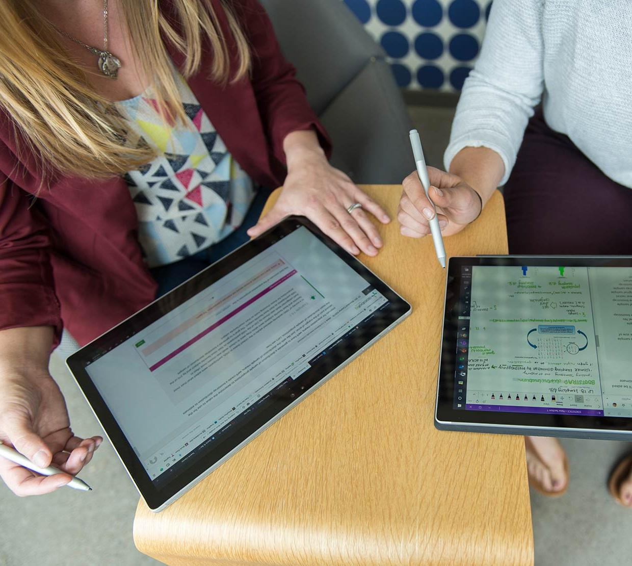 Two women working on iPads in the Learning Innovation Center