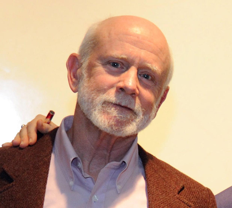 Robert Smythe in front of beige backdrop