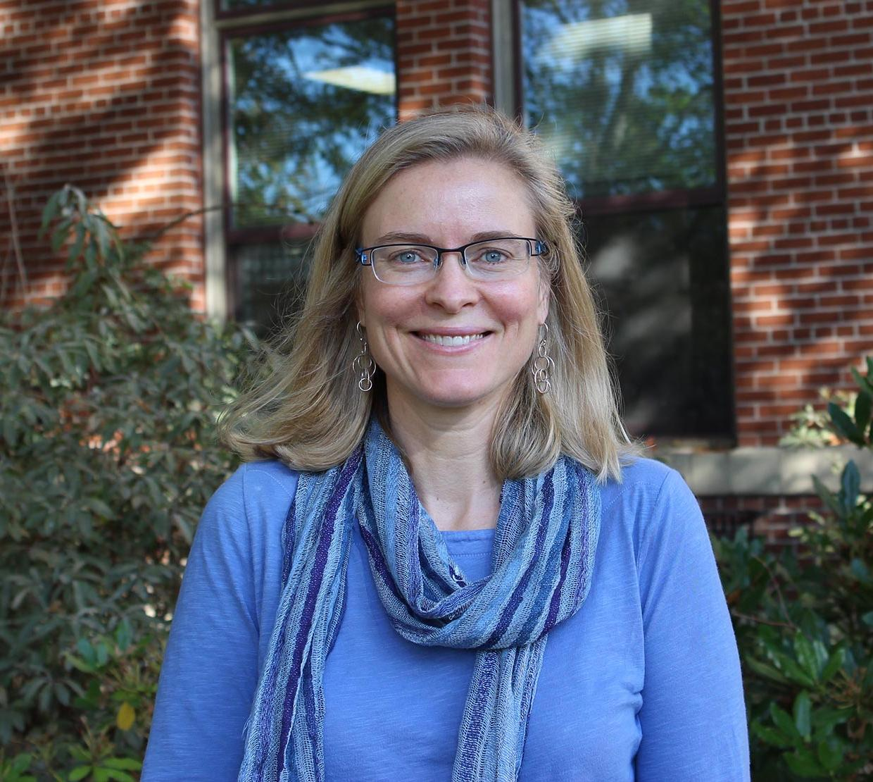 Mary Beisiegel standing in front of Kidder Hall