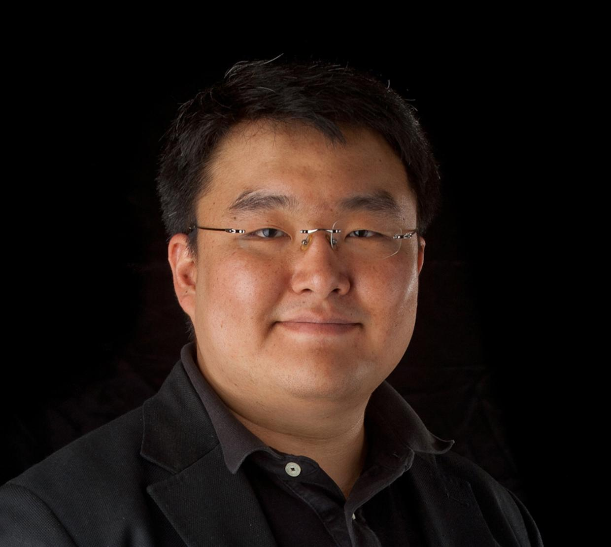 Paul Ha-Yeon Cheong in front of black backdrop