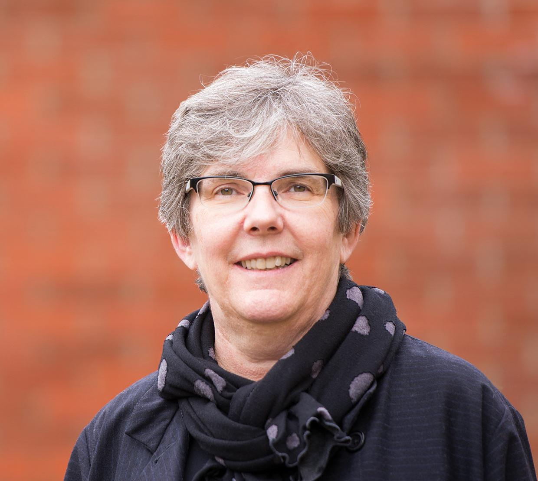 Heidi Schellman in front of brick wall
