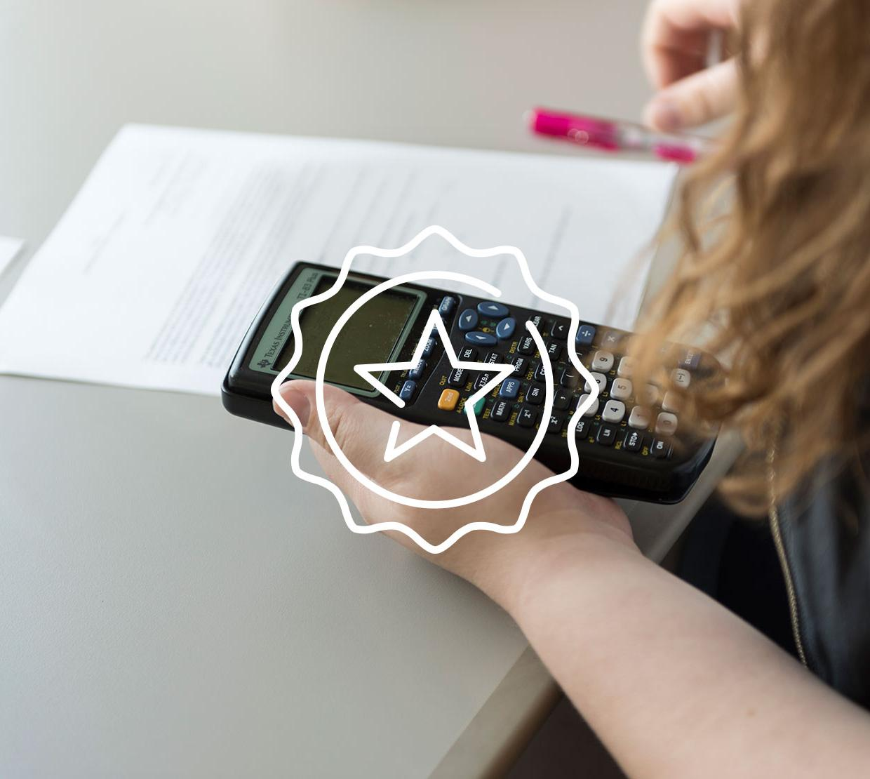 Star icon above female working on homework with calculator