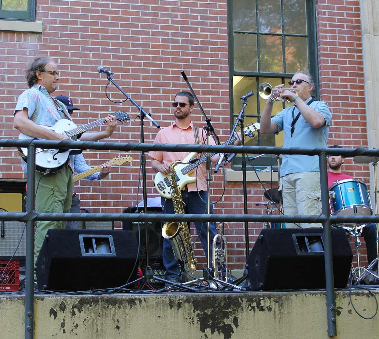 Band playing on outdoor stair set
