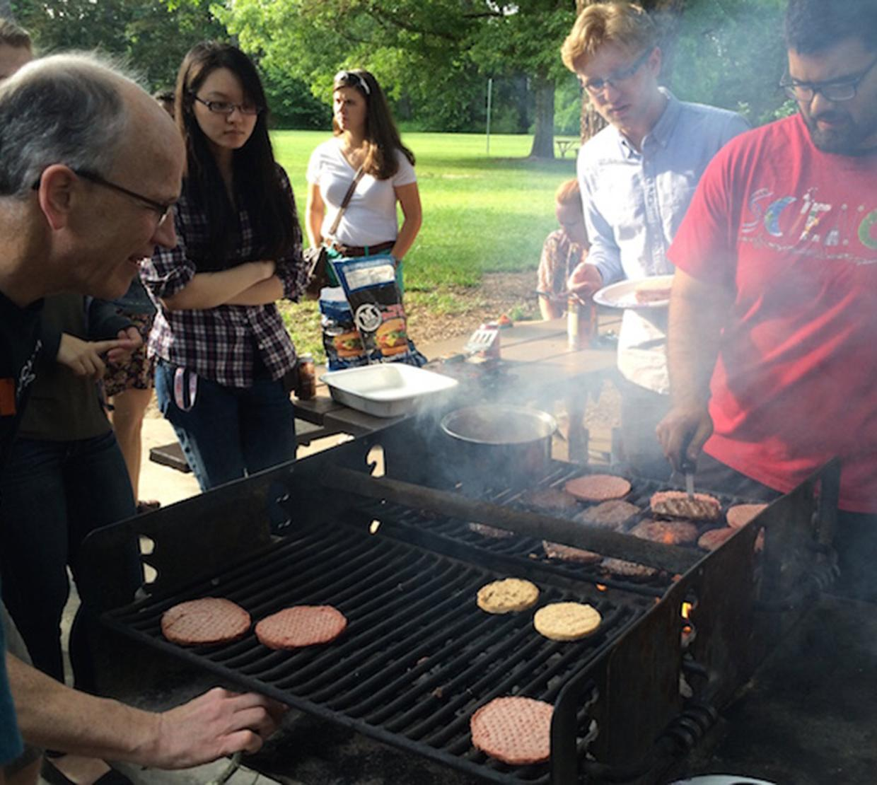 Andy Karplus and students grilling burgers in park