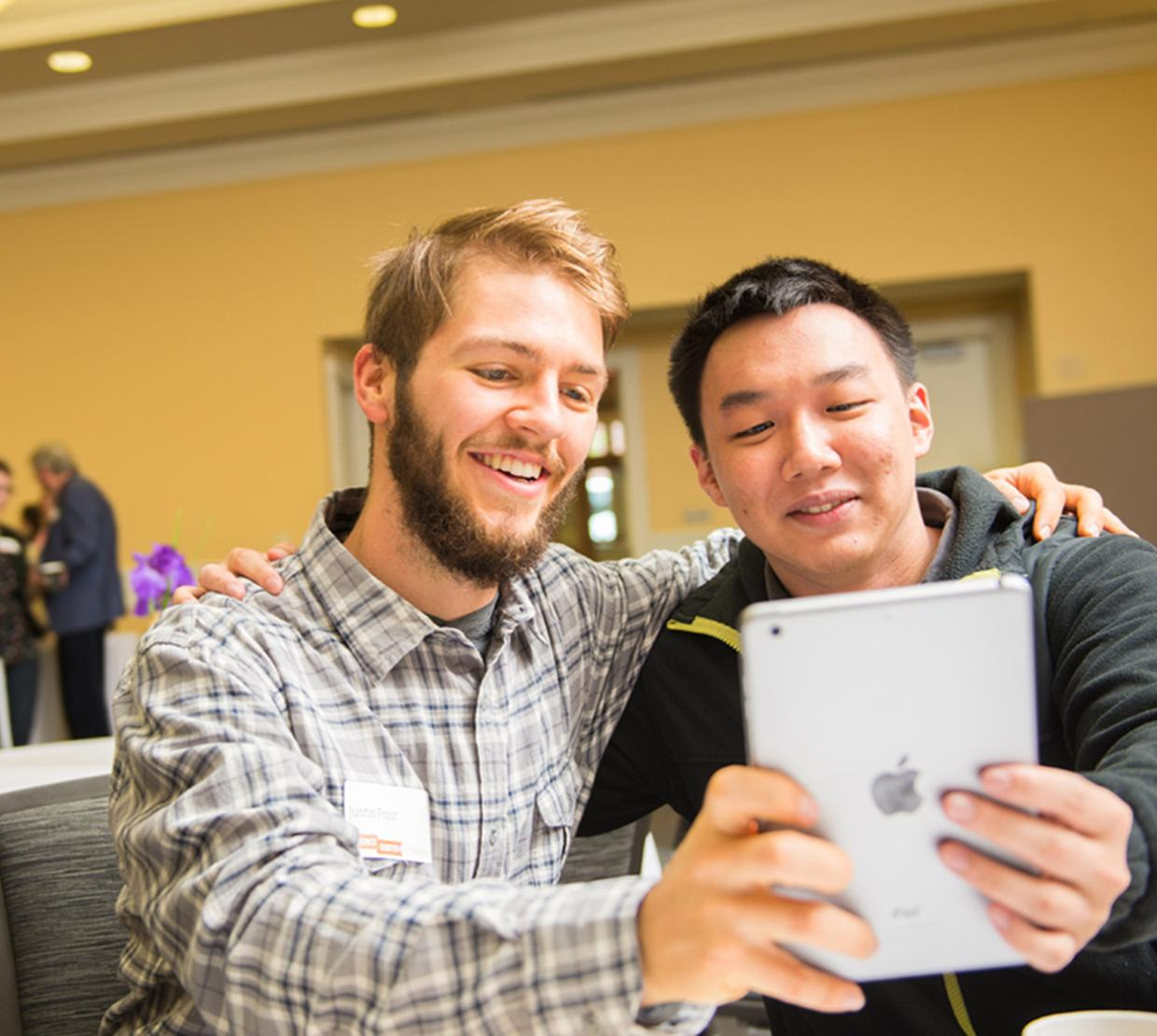 Justin Frost and colleague taking selfie on iPad