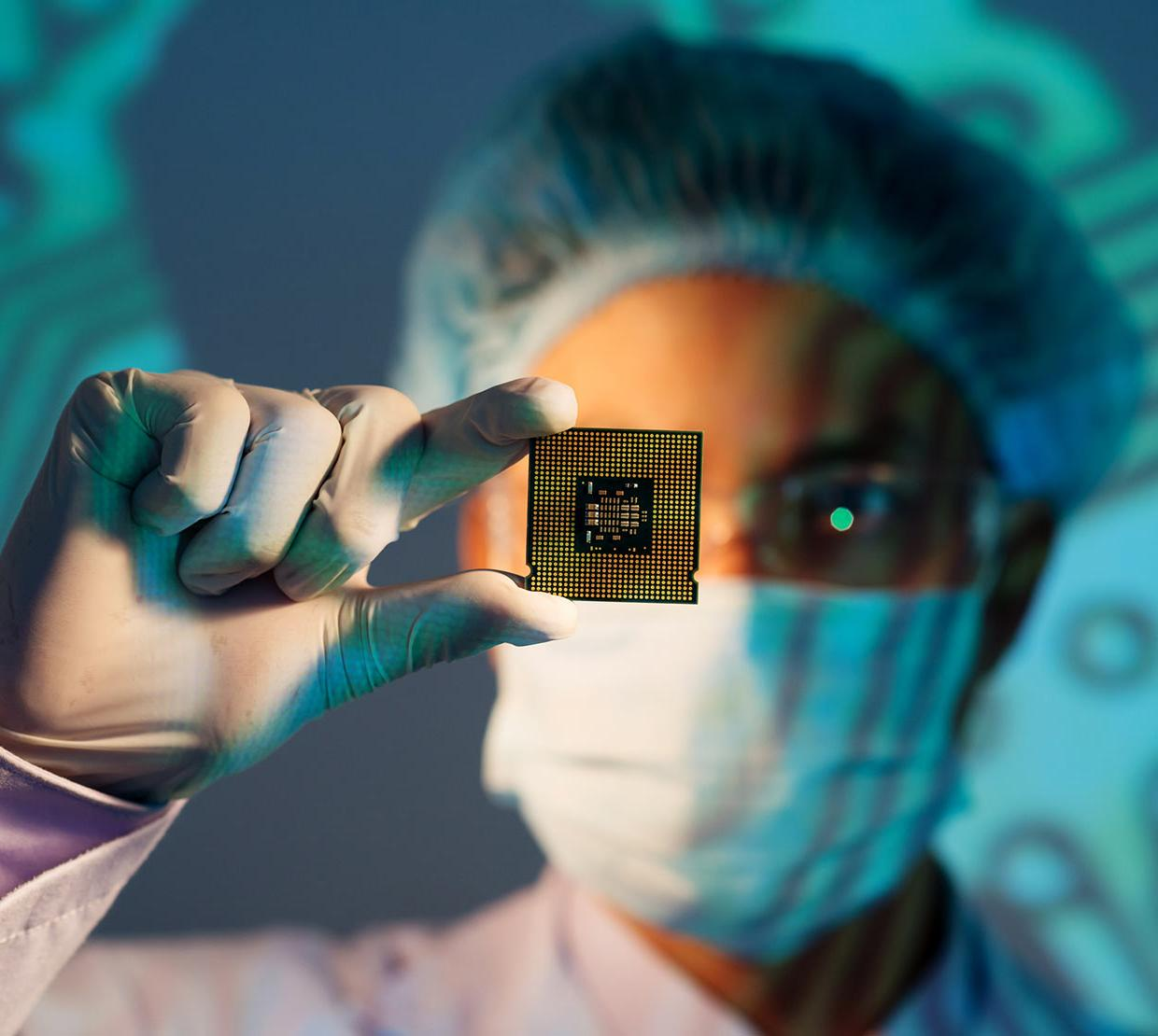 Scientist holding microchip in lab
