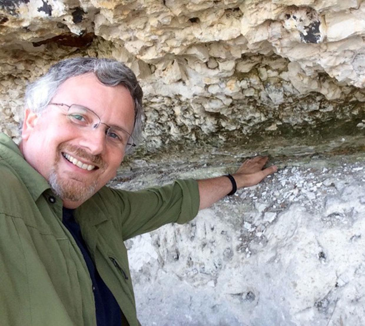 Ariel Anbar checking out rock samples in boulder