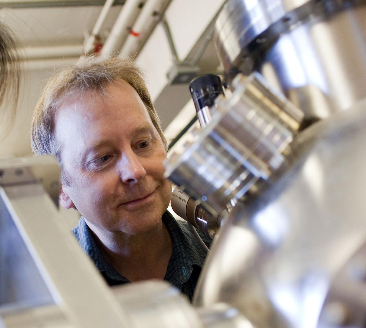 Doug Keszler looking though instruments in lab