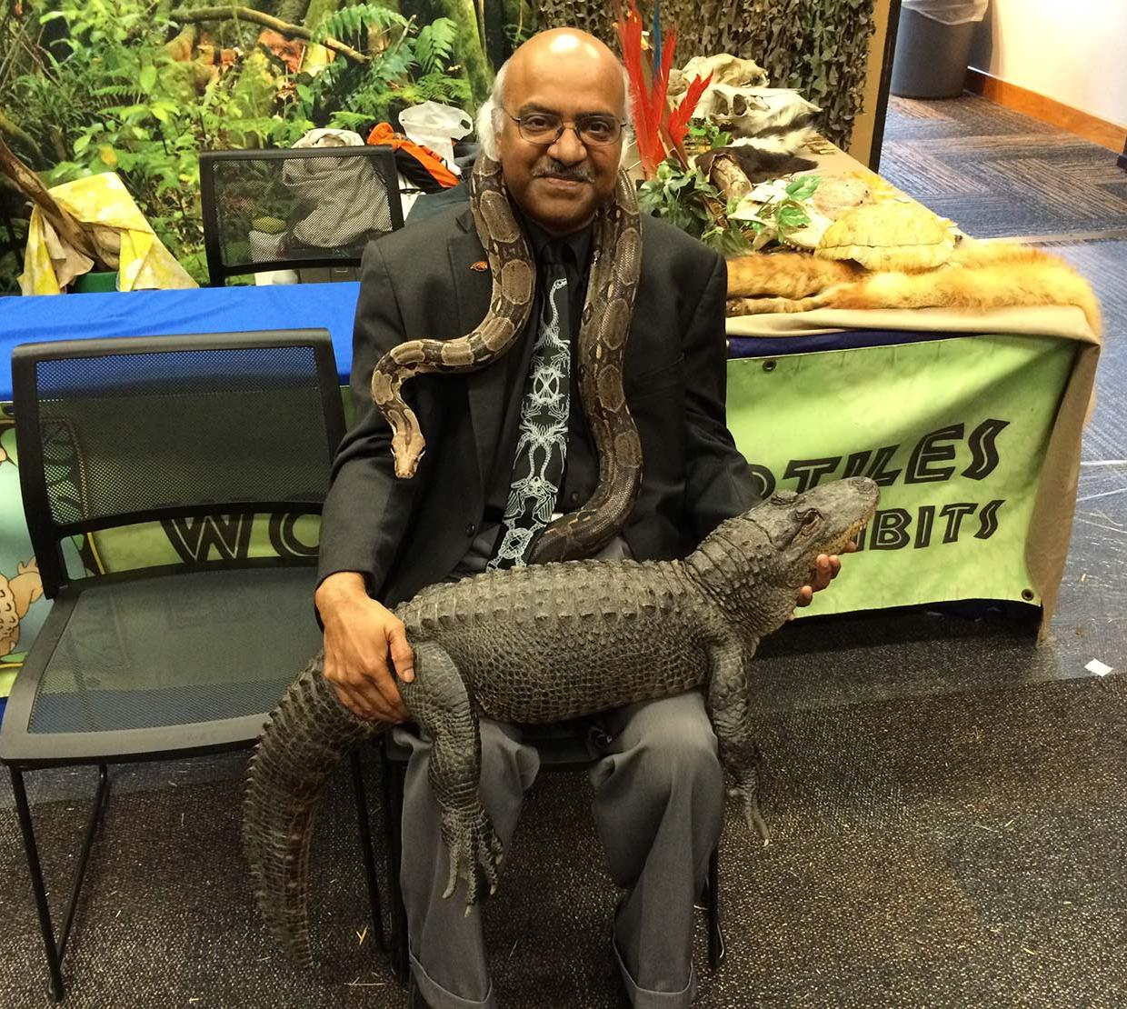 Sastry Pantula sitting with snake and crocodile