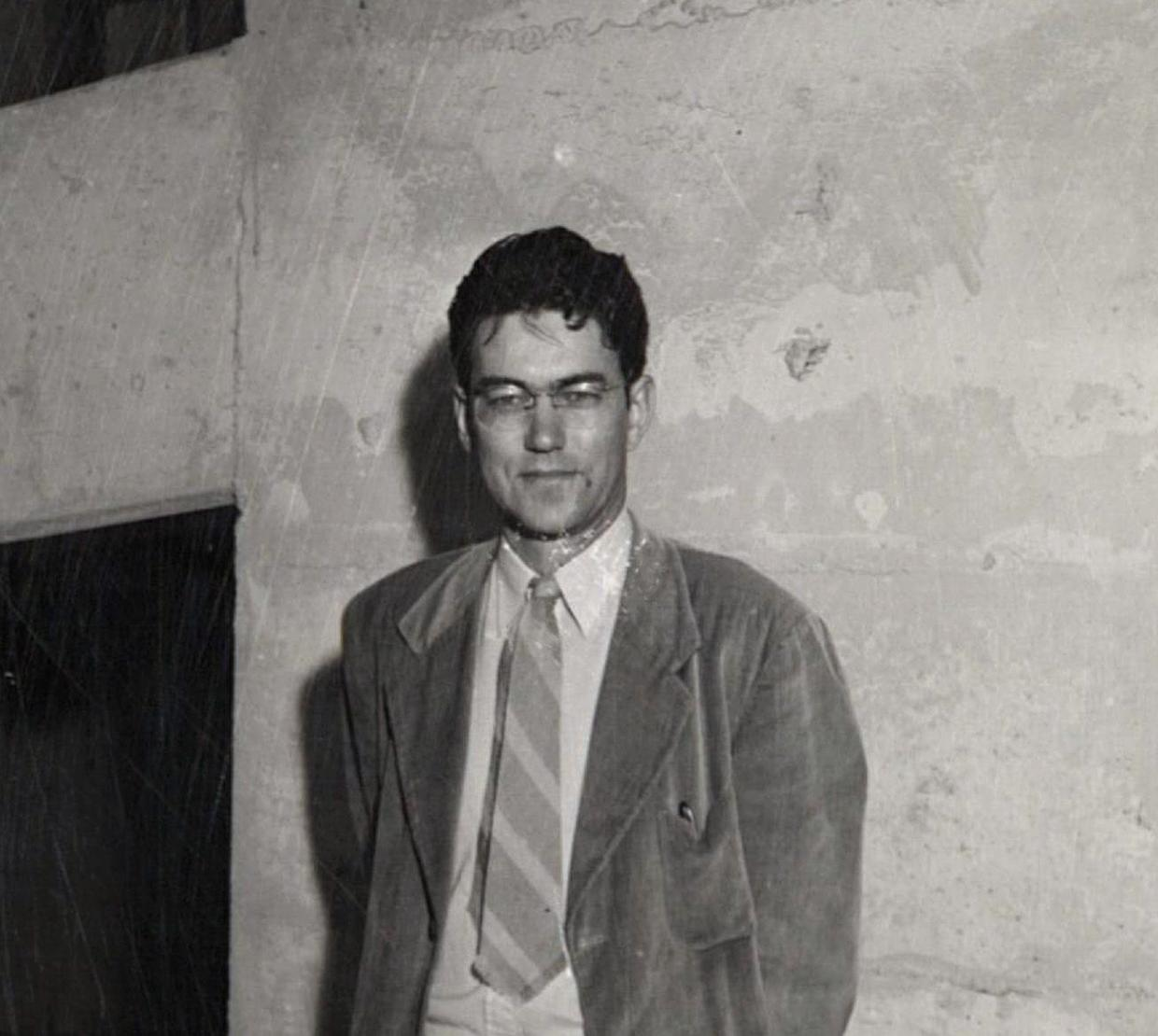 Vintage black and white picture of Arvid T. Lonseth in front of concrete wall