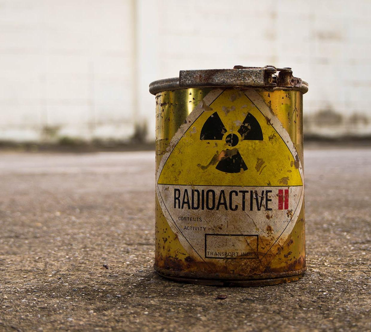 Radioactive waste bucket in concrete backdrop