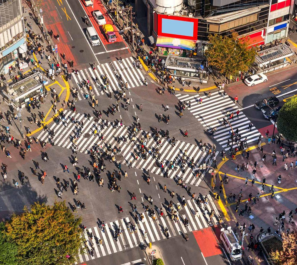 arial view of citizens walking through busy intersection in Japan
