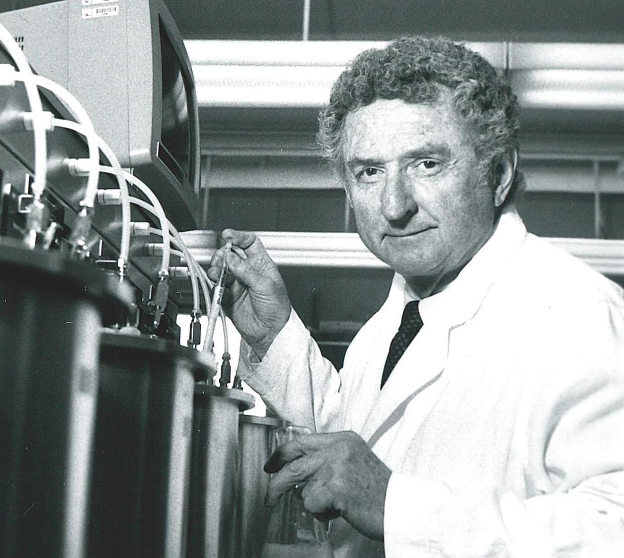 black and white photo of William Sandine working with lab equipment