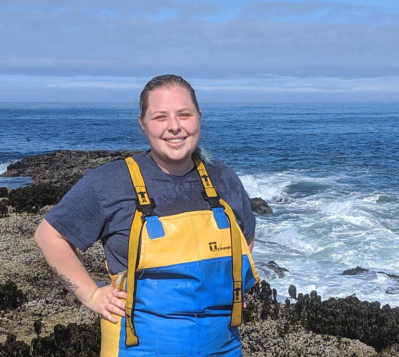 Chantelle MacAdams next to the ocean on a rock