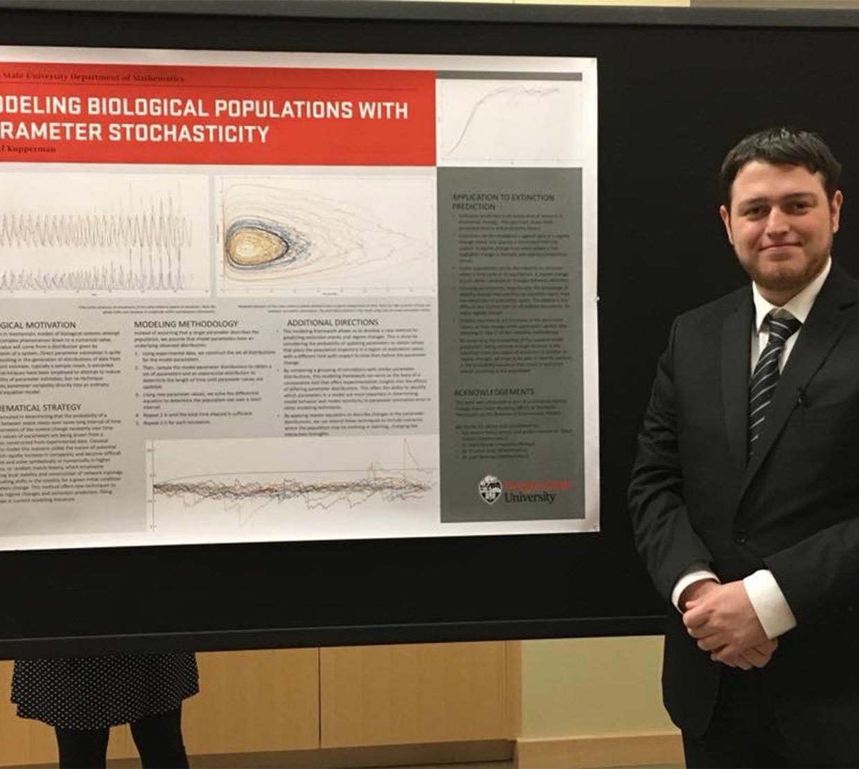 Michael Kupperman in front of his research poster