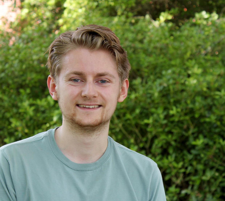 Ryan Tollefsen in front of Kidder Hall