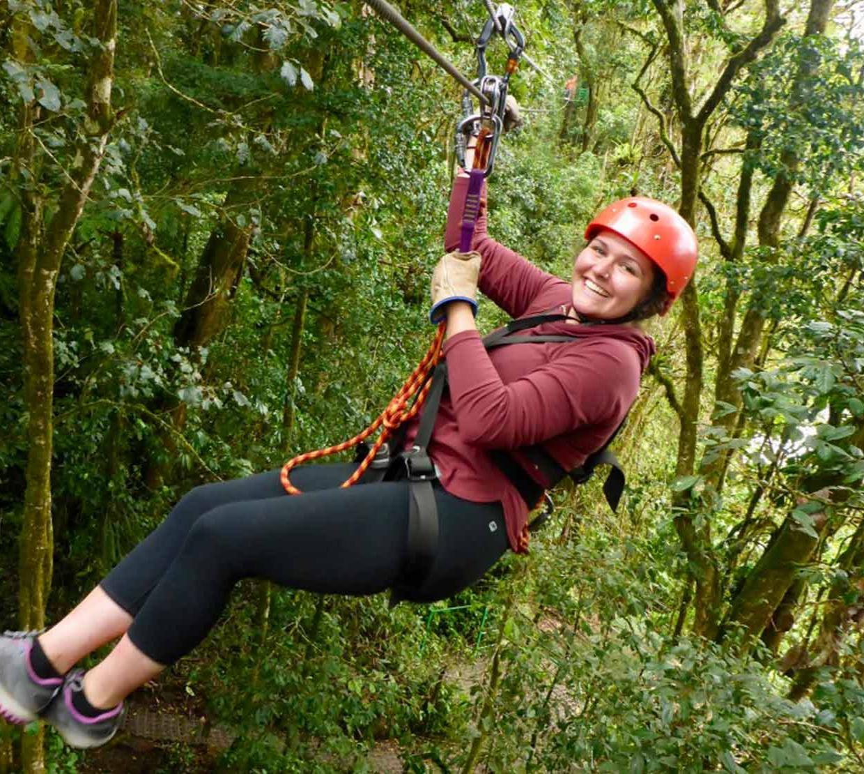 Katrina Ann Hiebel zip lining down forest