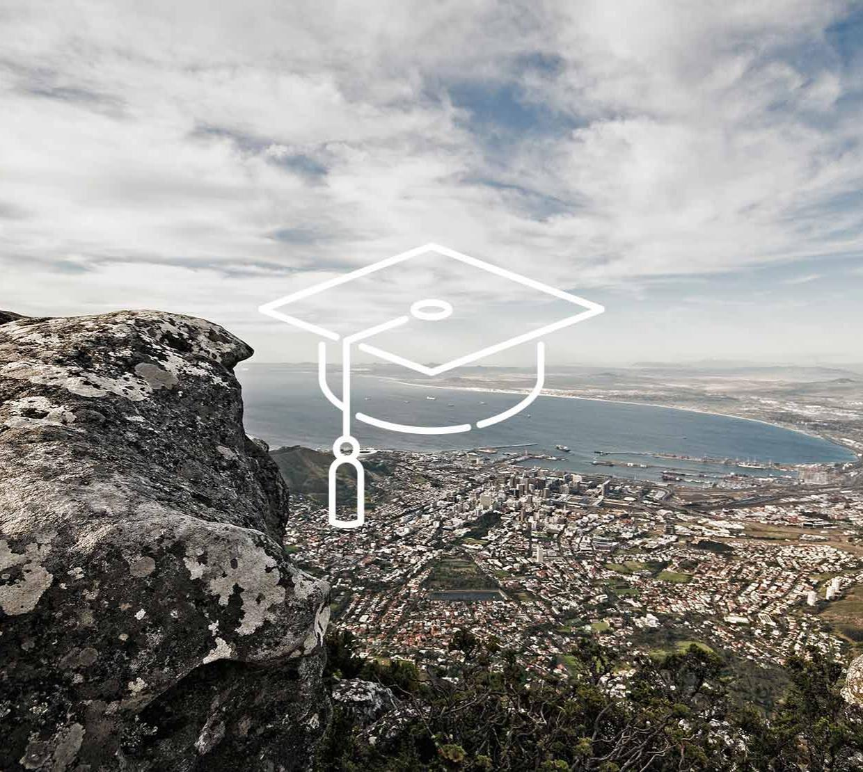 Graduation cap icon above South Africa coastal city