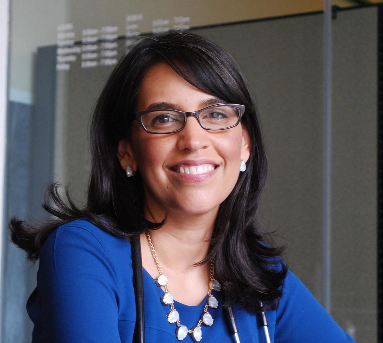 Eva Galvez sitting in office space