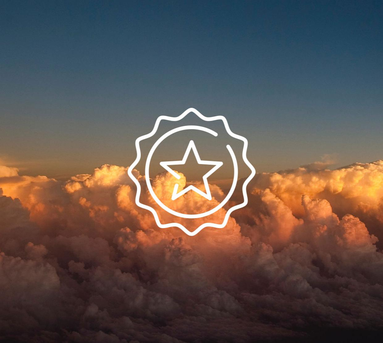 star icon above image of clouds at sunset