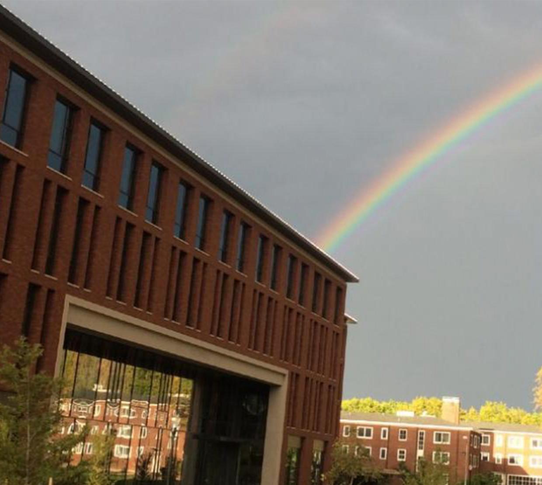 A rainbow peering behind Austin Hall.