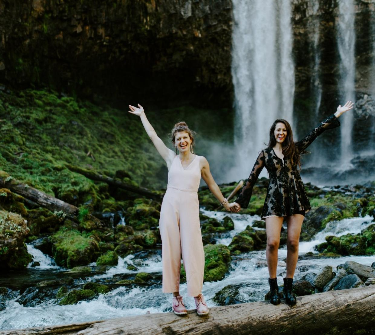 Heather Masson-Forsythe with her sister, Margaux, at a waterfall