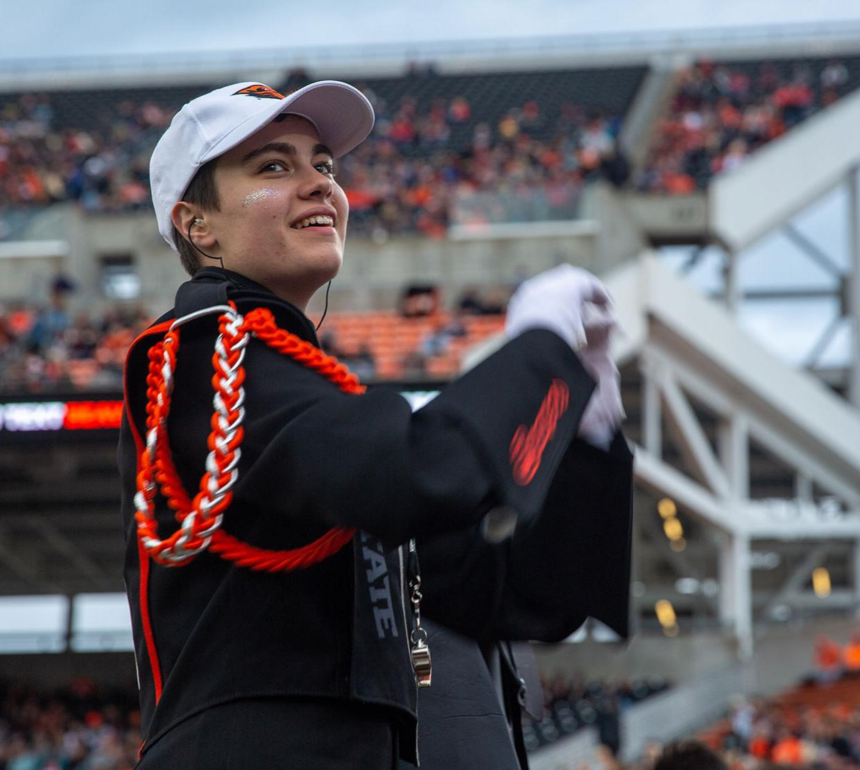 Linus Unitan is a drum major and sousaphone player in Oregon State's marching band.