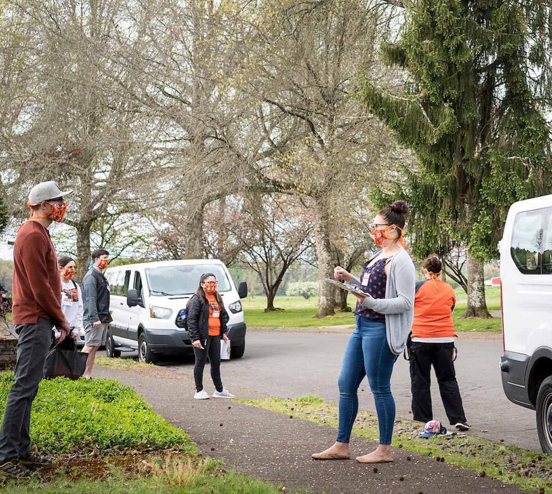 TRACE field staff door-to-door sampling in Corvallis neighborhood.