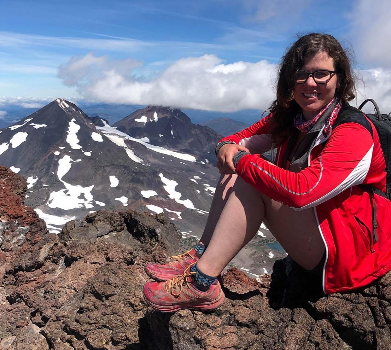 Audrey Dickinson on a mountain top