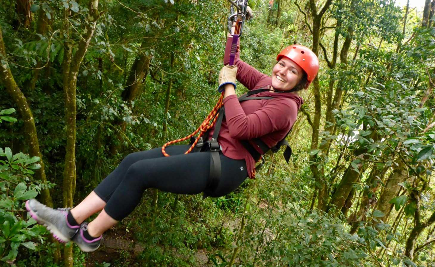Rachel Ann Blood zip lining through tropical rainforest