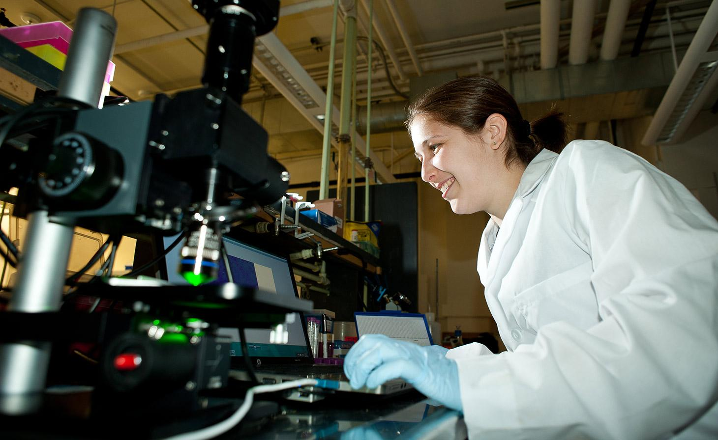 Student working with Genome research machinery