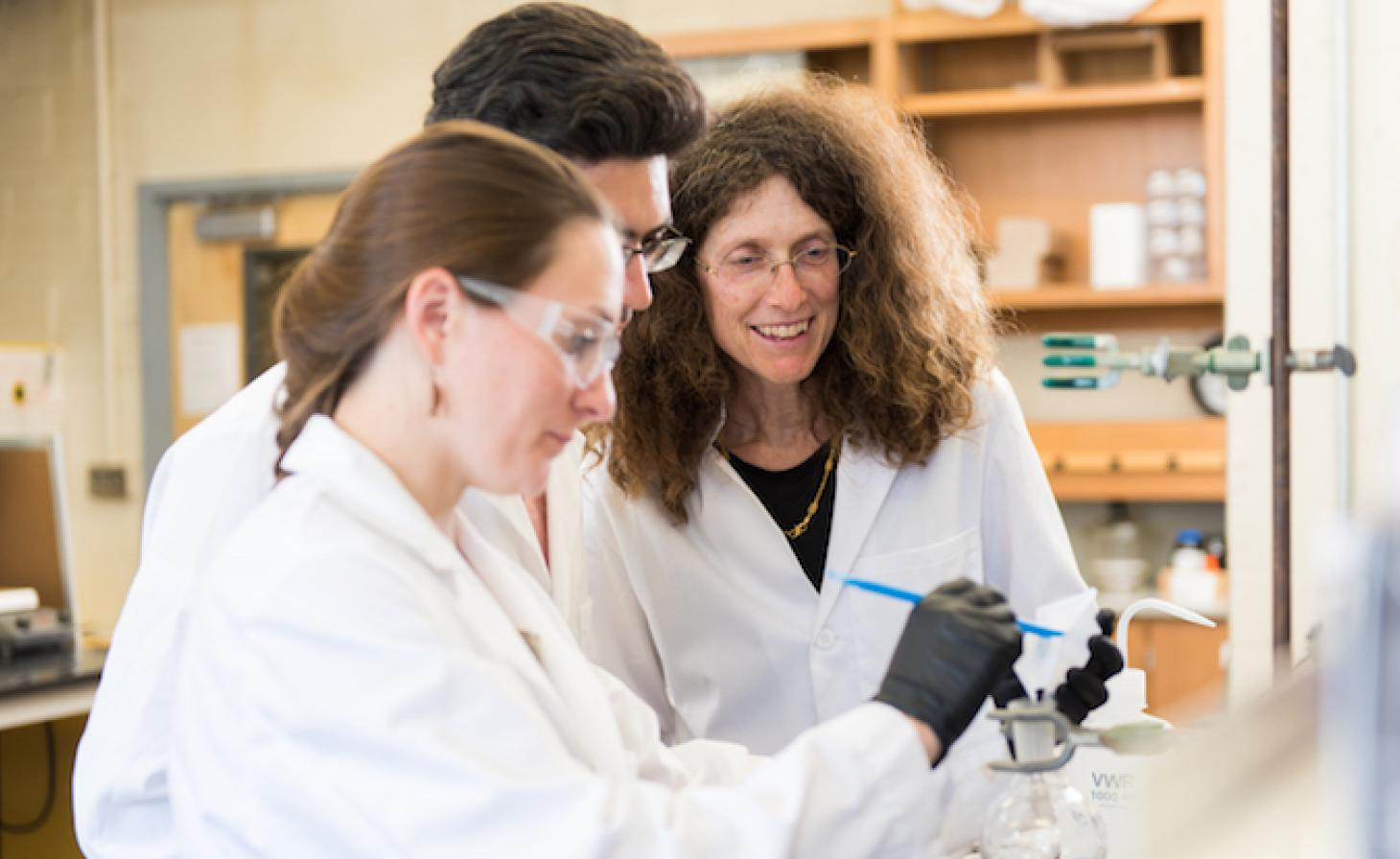 May Nyman in the lab with students