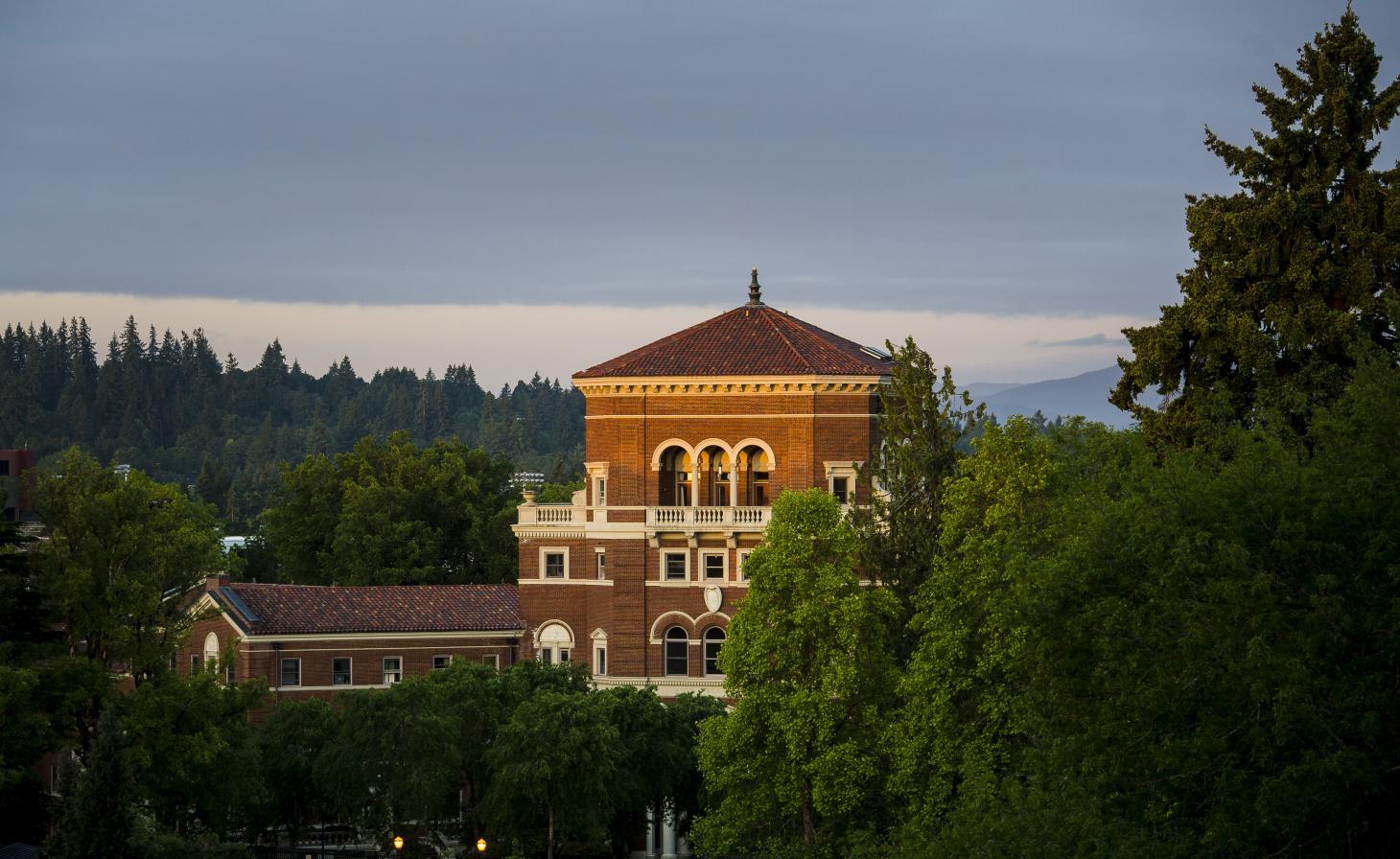 Weatherford Hall peering over trees