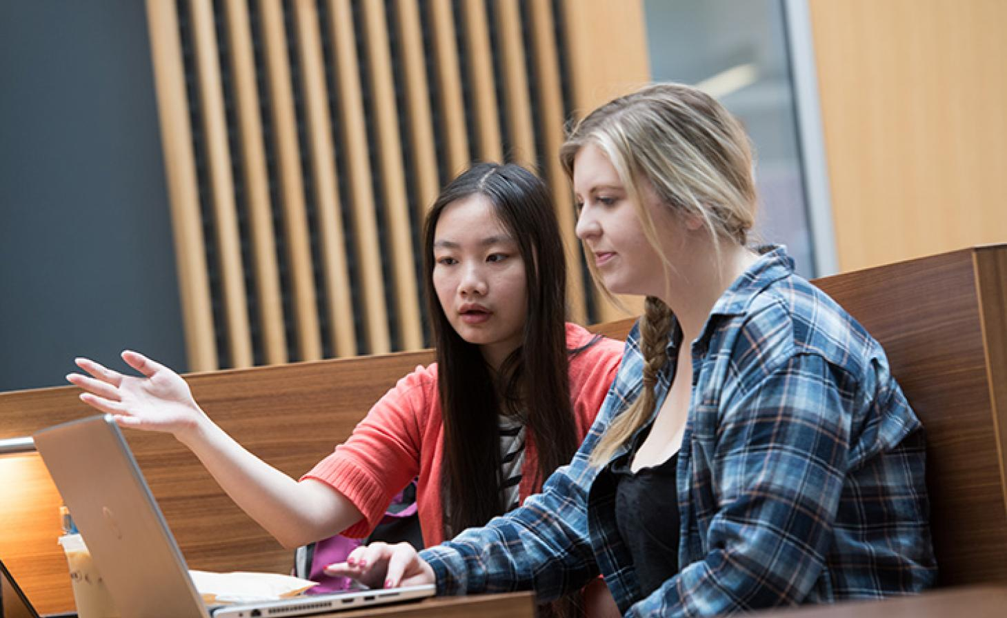 female students working on homework in Austin Hall