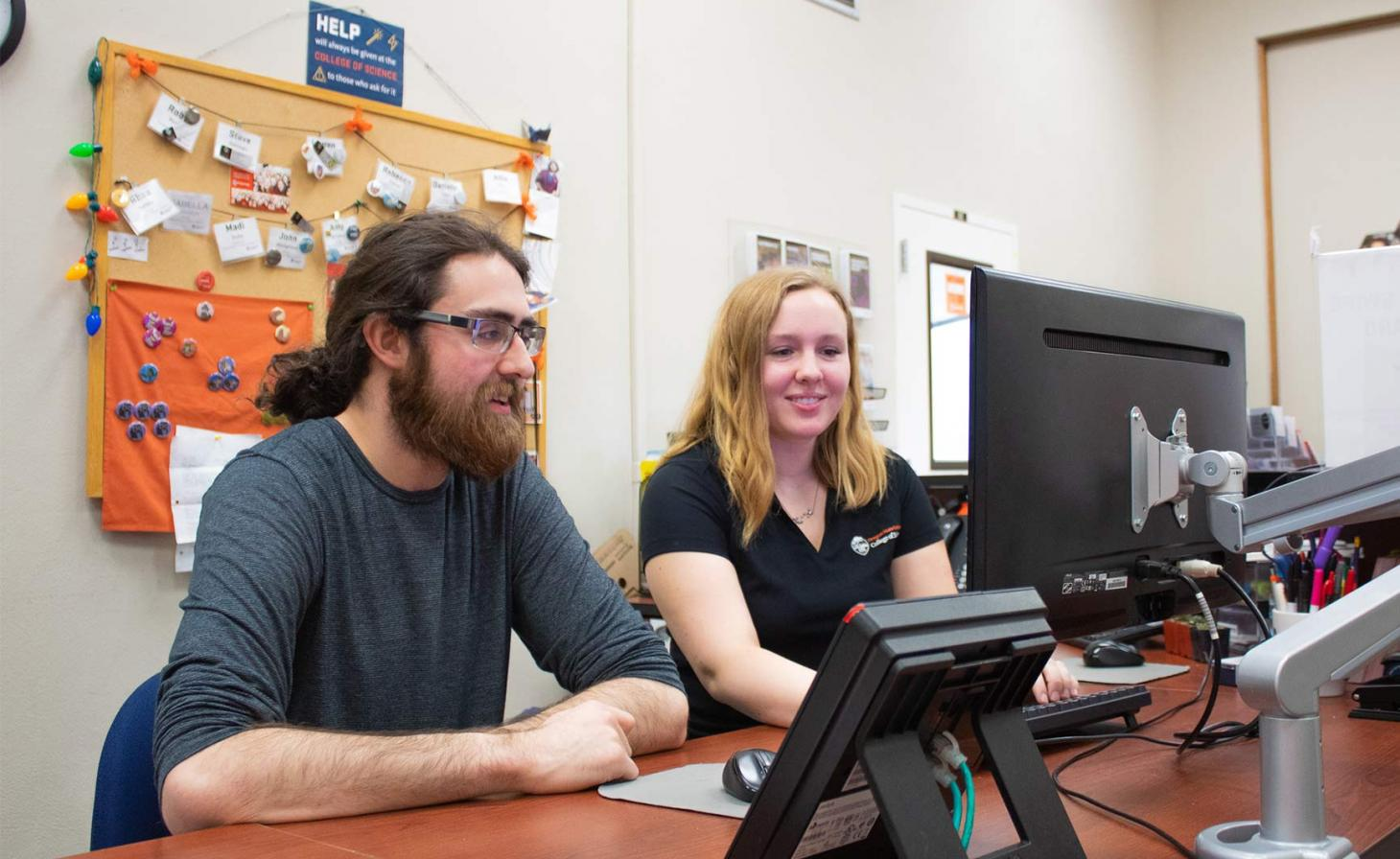 Steve Dobrioglio and Madeline Bloom working on computer in the science success center