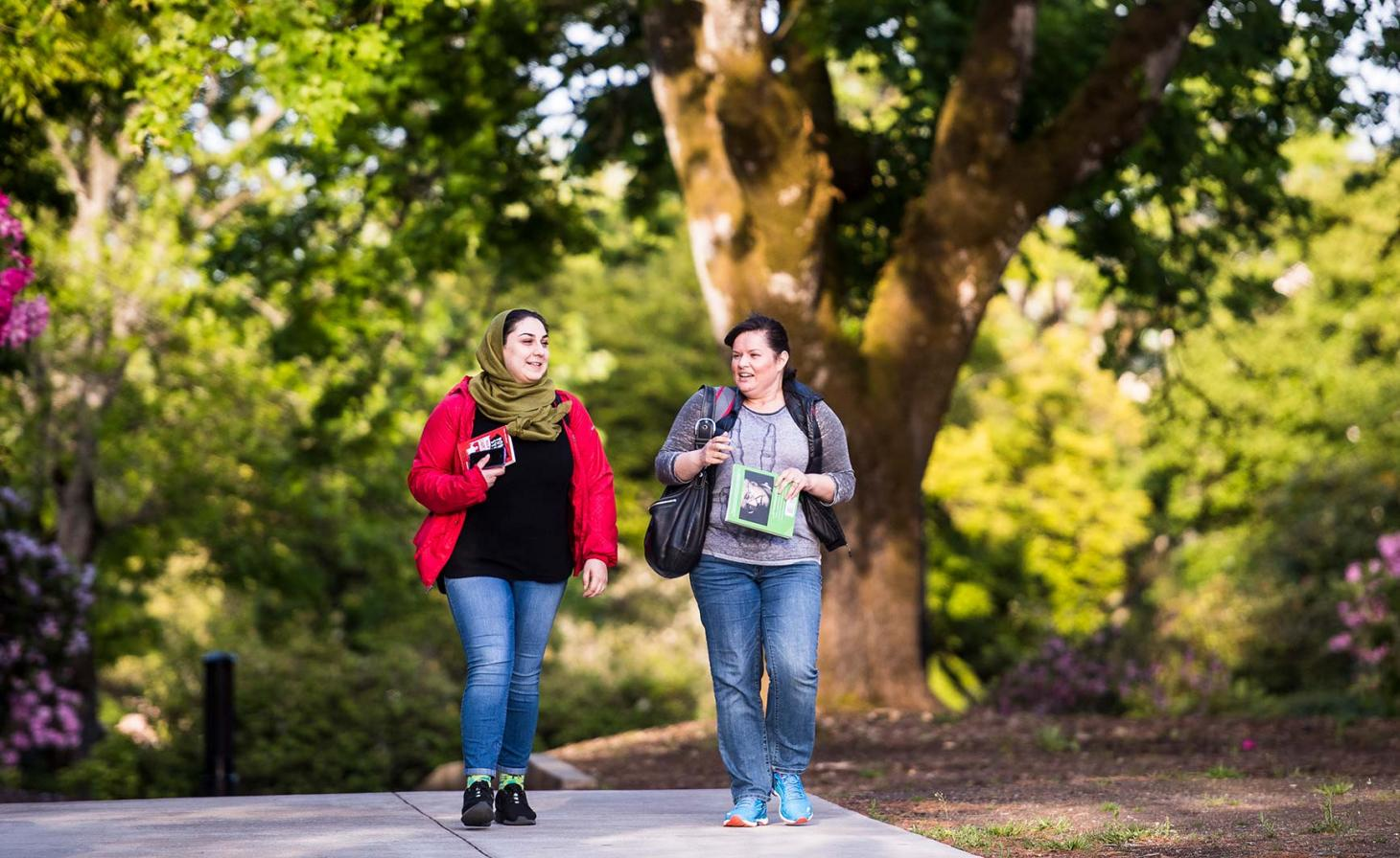 Two students walking on OSU Corvallis campus.