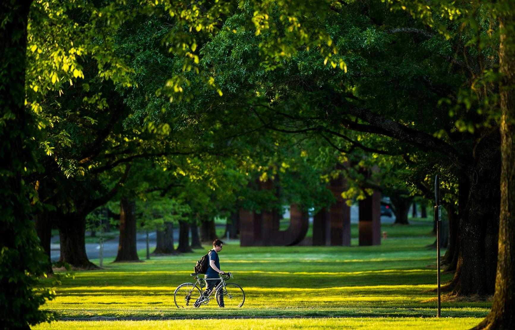 Walking bike outside West Hall lawn