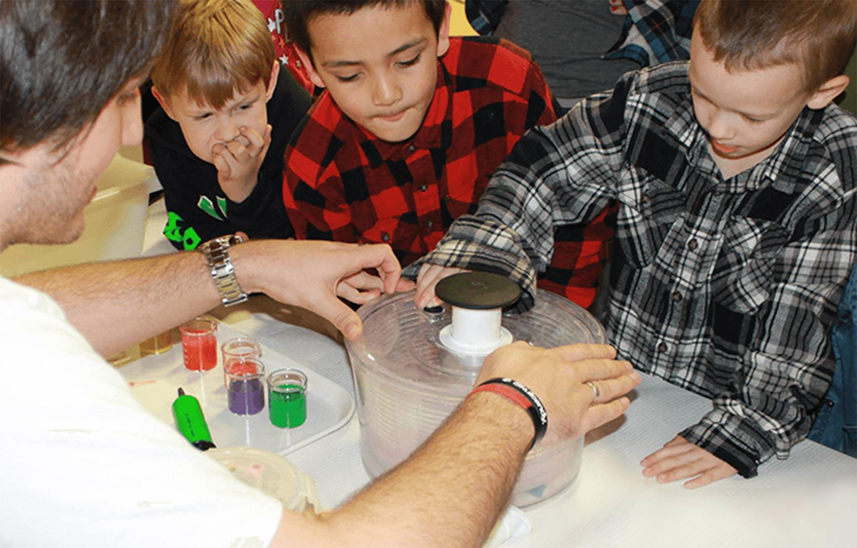 Children looking at science booth