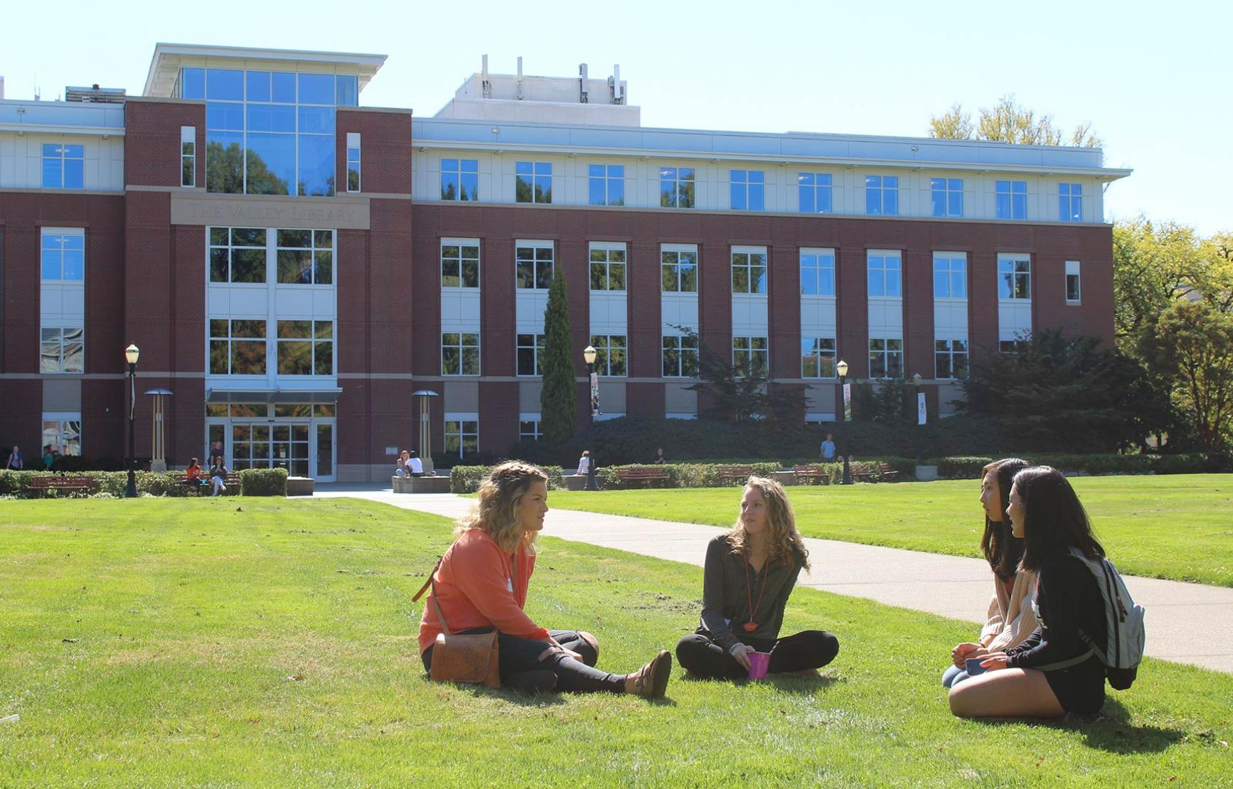 Students sitting on Valley Library lawn