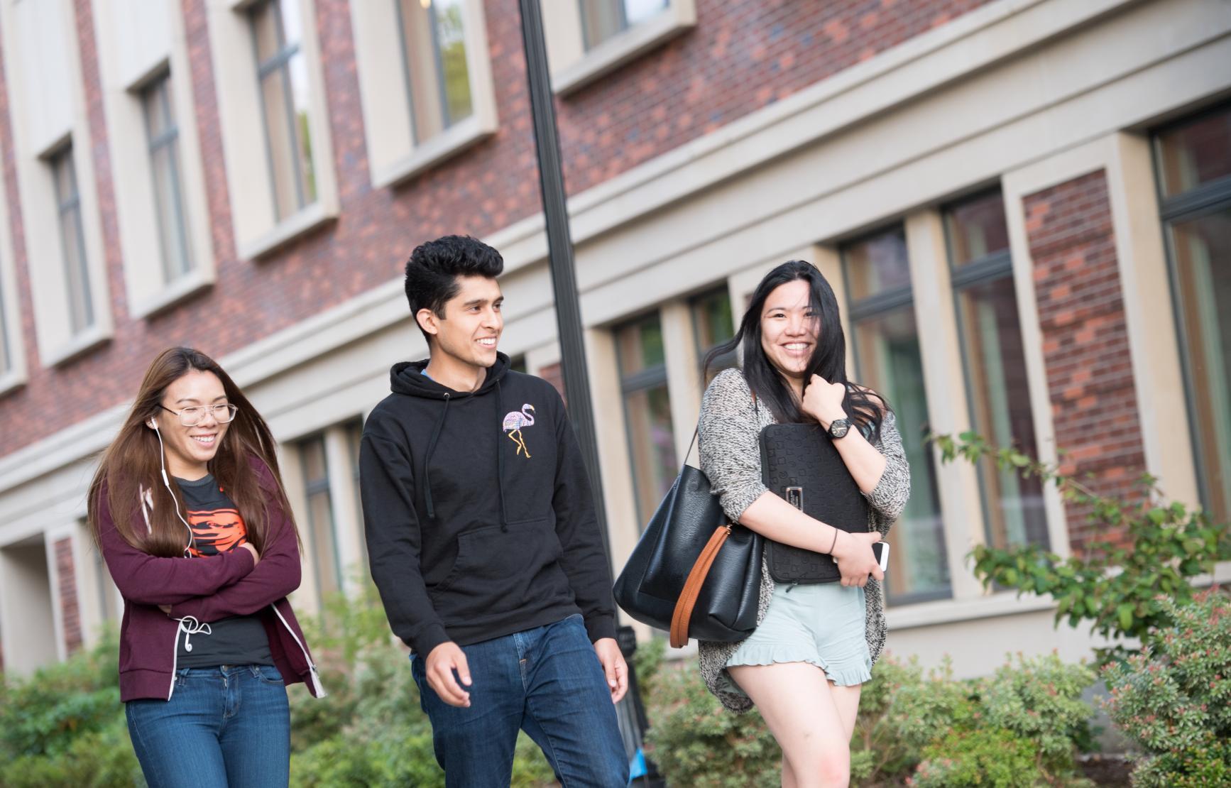 Three OSU students walking through the quad