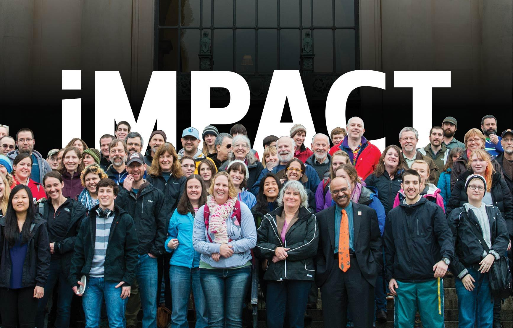 IMPACT title behind group photo of staff and faculty on Memorial Union steps