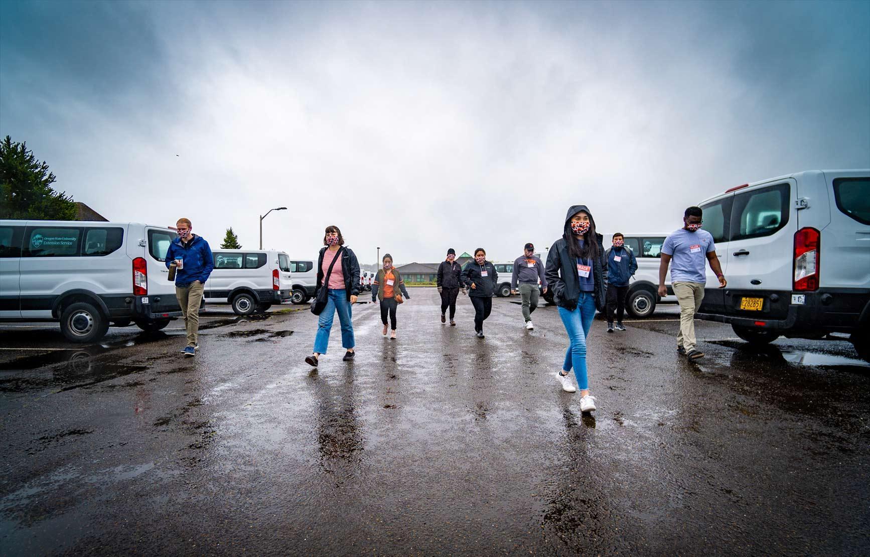 TRACE field staff walking along parking lot.