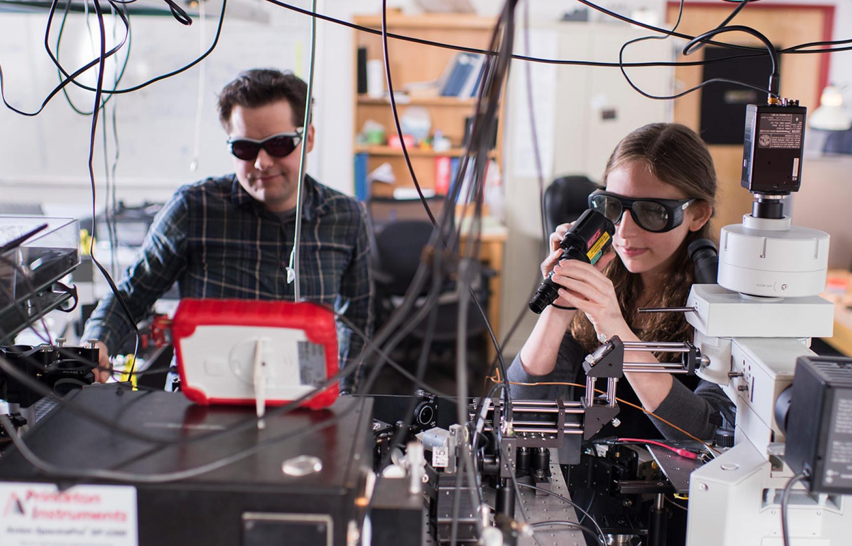 Matt Graham and colleague working in lab.