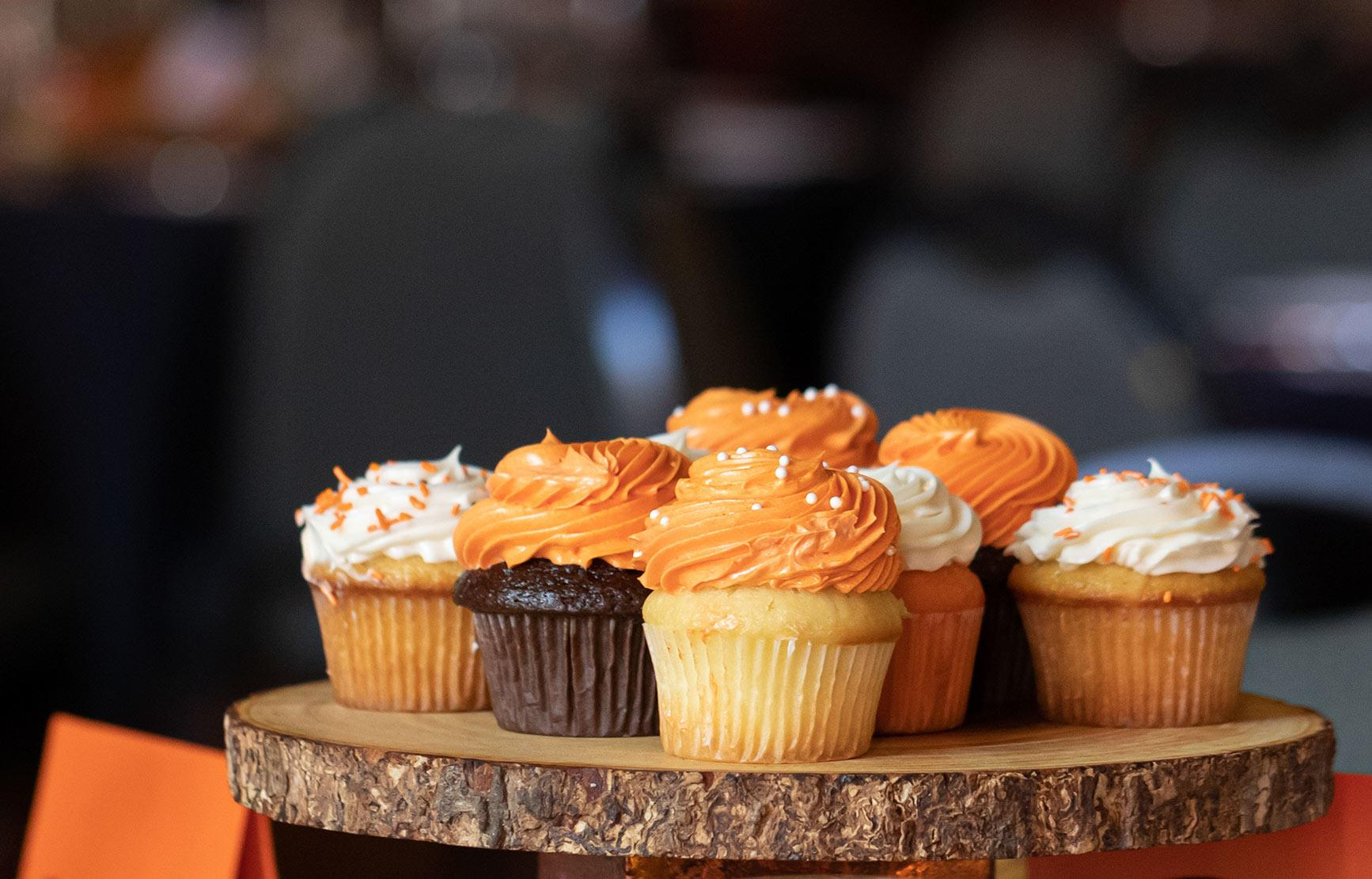 Orange and white cupcakes served at an OSU event.