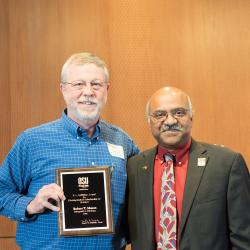 Robert T. Mason receiving award from Sastry Pantula