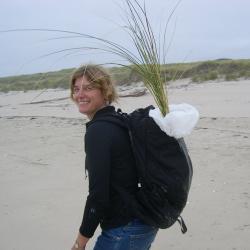 Sally D. Hacker walking though sand dune