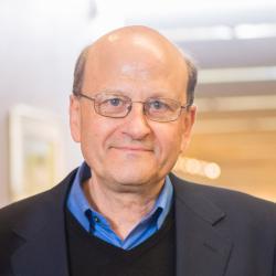 Enrique Thomann standing in office hallway